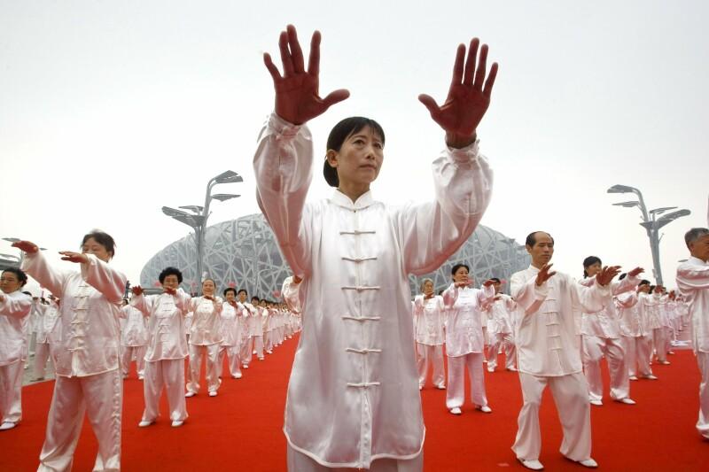 اجرای دست جمعی تای چی در همایش تای چی برای حفظ سلامت سالمندان، چین
